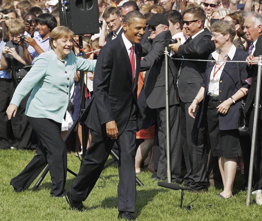 German Chancellor Angela Merkel and President Obama walk across the South Lawn of the White House on June 7, 2011, during an arrival ceremony. (Associated Press)