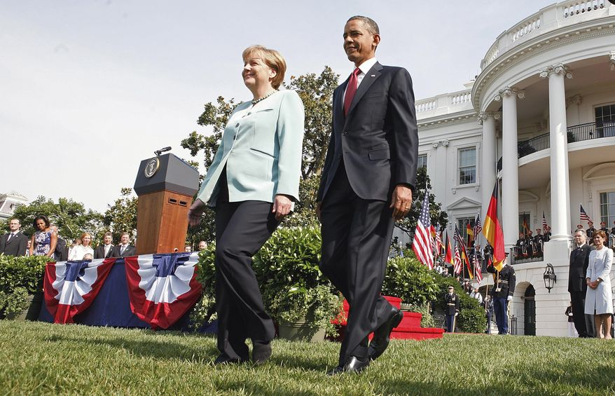 President Obama and German Chancellor Angela Merkel walk across the South Lawn of the White House on June 7, 2011, during an arrival ceremony. (Associated Press)