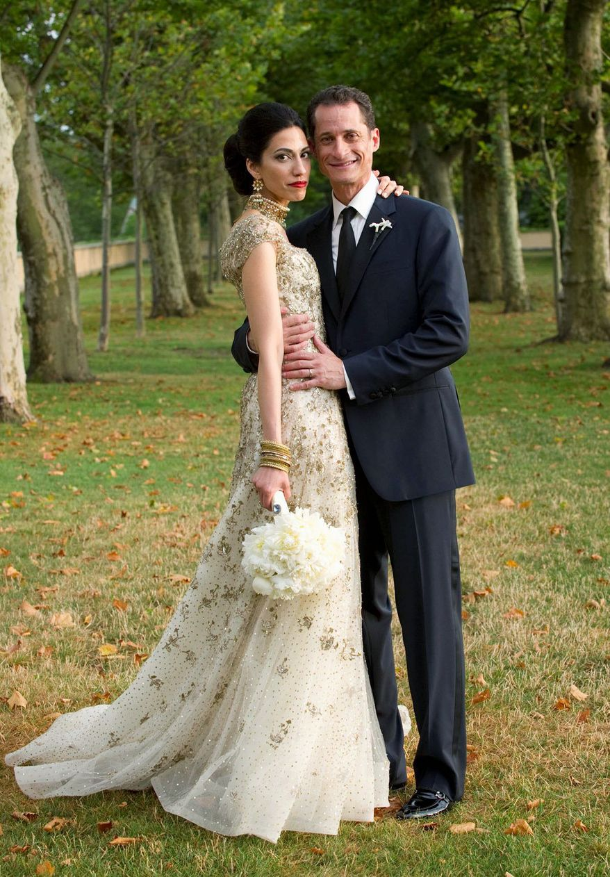 Rep. Anthony D. Weiner and his wife Huma Abedin, a close aide to Secretary of State Hillary Rodham Clinton, were married in July. They posed for a formal wedding portrait at the Oheka Castle in Huntington, N.Y. (Associated Press)