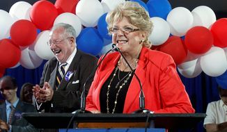 Carolyn Goodman celebrates with supporters after being elected mayor of Las Vegas on Tuesday. She will succeed her husband, Oscar Goodman (left), the much-loved mayor for the past 12 years who was barred by term limits from running again. (Associated Press)
