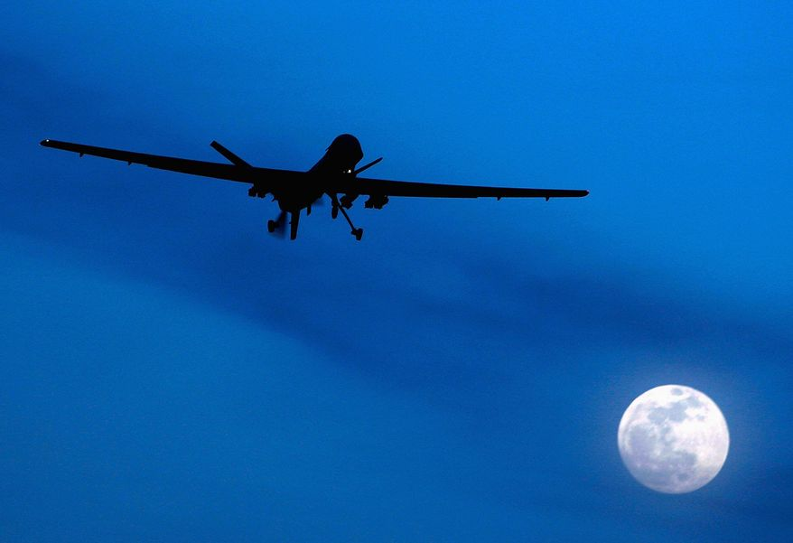 **FILE** A U.S. Predator drone flies over southern Afghanistan. (Associated Press)