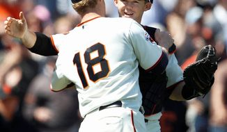 Giants catcher Eli Whiteside celebrates with starting pitcher Matt Cain after Wednesday's victory against the Nationals in San Francisco. (Associated Press)