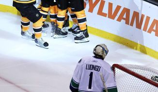 Boston Bruins center Rich Peverley celebrates his goal with teammates as Vancouver Canucks goalie Roberto Luongo looks on during Game 4 of NHL Stanley Cup finals. Peverley had two goals in the Bruins' 4-0 win. The series is now tied 2-2. (AP Photo/The Canadian Press, Jonathan Hayward)
