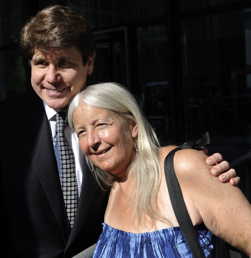 Former Illinois Gov. Rod Blagojevich poses with a supporter as he leaves court during his second corruption trial on Tuesday, June 7, 2011, in Chicago. Blagojevich insisted on the witness stand that he never sought to sell or trade President Obama's vacated U.S. Senate seat for a top job or campaign cash. (AP Photo/Paul Beaty)
