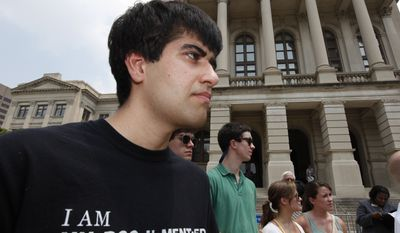 ** FILE ** Immigration activist Mohammad Abdollahi (left) stands outside the Georgia Capitol in Atlanta on Thursday, June 2, 2011, during a press conference at which it was announced that several civil liberties groups had file lawsuits challenging Georgia's new immigration law, saying it violates state and federal law. (AP Photo/John Bazemore)
