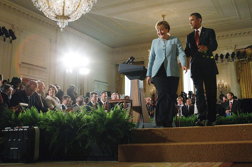 "President Obama and German Chancellor Angela Merkel depart after a joint news conference in the East Room of the White House on Tuesday. ""The chancellor and I have been clear: Gadhafi must step down and hand power to the Libyan people,"" Mr. Obama said. (Associated Press)"