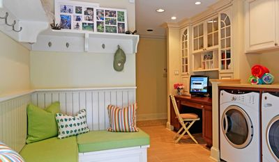 Today's mudrooms can be functional, yet stylish, as they bring order and organization into a home. Some families choose to link the mudroom and laundry room and even include a small desk or workstation. (Photo courtesy of Case Design/Remodeling Inc.)