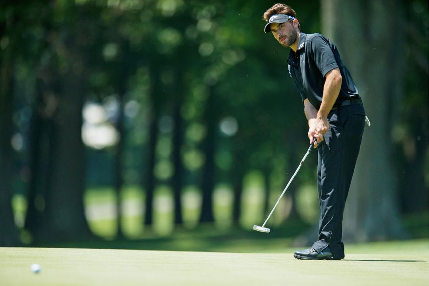 Ty Tryon strikes a putt during the U.S. Open qualifying tournament at Woodmont Country Club in Rockville on Monday. Tryon shot 6-under 135 for 36 holes and made the cut. (Drew Angerer/The Washington Times)