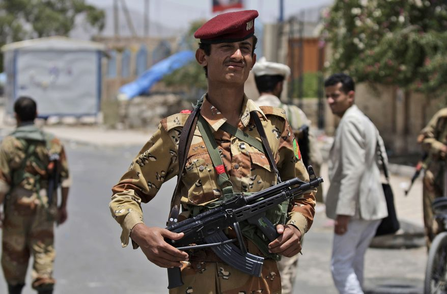 A Yemeni army officer stands on duty at a checkpoint in Sanaa, Yemen, on Thursday, June 9, 2011. (AP Photo/Hani Mohammed)