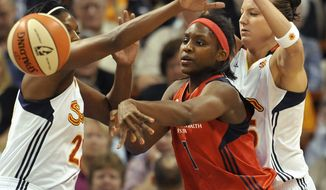 Washington Mystics' Crystal Langhorne (shown in a game against the Connecticut Sun) had 30 points and 13 rebounds to lead the Mystics to a 98-90 OT victory against the Atlanta Dream Thursday night. (AP Photo/Jessica Hill)
