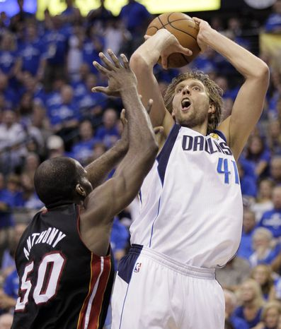 Dallas Mavericks' Dirk Nowitzki shoots over Miami Heat's Joel Anthony during the second half of Game 5 of the NBA finals. Dallas won 112-103 and is one game from an NBA Championship. Nowitzki had had 29 points, six rebounds and three assists in the game. (AP Photo/Mark Humphrey)