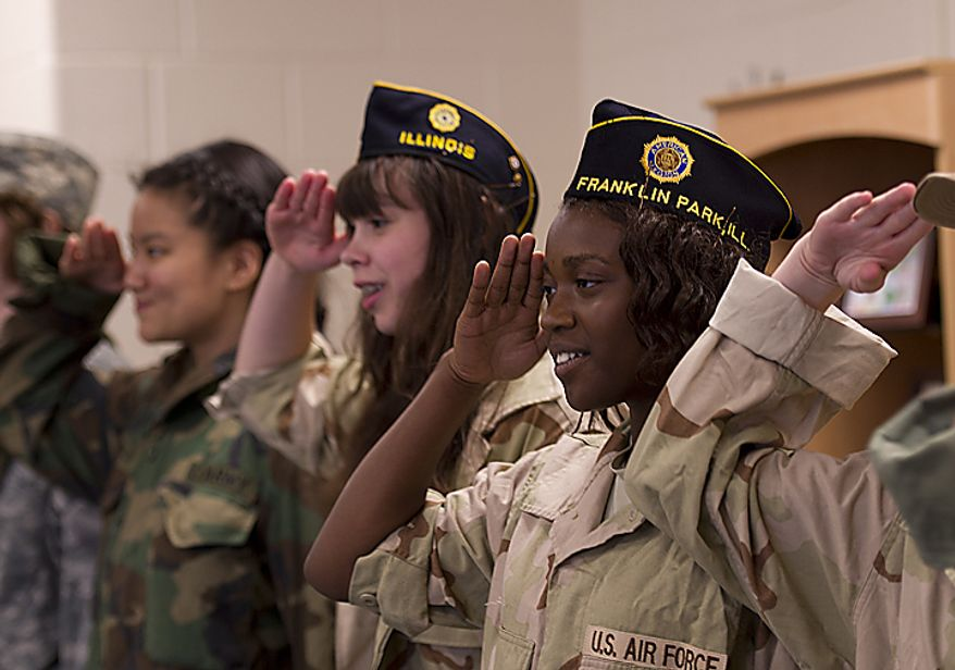 "Students in the Rocky Run Middle School advanced year-long theatre salute during a musical performance of ""This is the Army Mr. Jones"" for World War II veterans during the school's annual World War II Day on Thursday, June 9, 2011. (Barbara L. Salisbury/The Washington Times)"