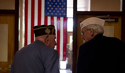 """Buck Shelton, left, of Fairfax, Va., who served in the Battle of the Bulge, walks down the hallway at Rocky Run Middle School in Chantilly, Va., on Thursday, June 9, 2011 with his friend Sandy MacNabb of Oakton, Va., who served in the U.S. Navy in Korea, China and the Formsa Straits. The WWII vets were at the school as part of its 10th annual World War II Day, called """"The Latest Generation Meets the Greatest Generation."""" The day included small-group interviews with WWII vets as well as panel discussions and World War II-inspired entertainment provided by the students. More than 100 vets participated in the day. (Barbara L. Salisbury/The Washington Times)"""