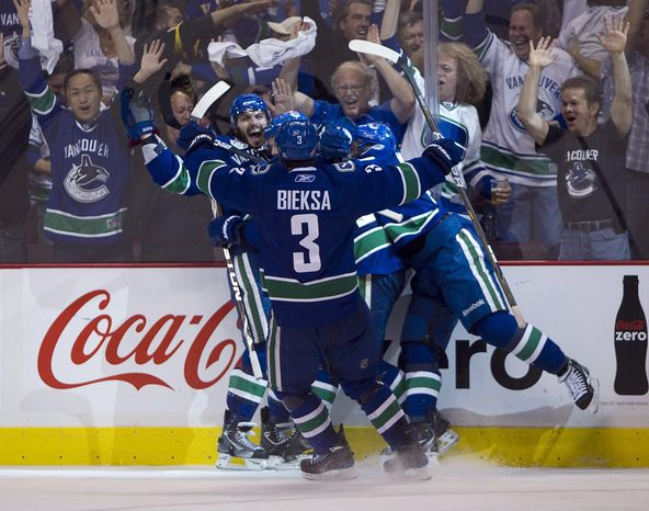 Vancouver Canucks right wing Maxim Lapierre celebrates with teammates after scoring against the Boston Bruins during the third period of Game 5 of the Stanley Cup finals. Lapierre's goal was enough to give the Canucks a 1-0 and a 3-2 series lead. (AP Photo/The Canadian Press, Darryl Dyck)
