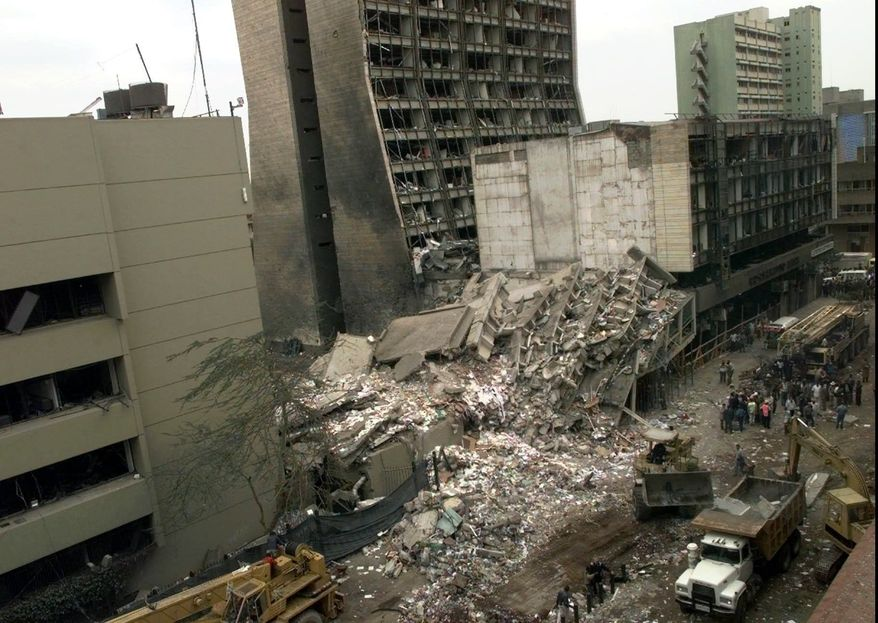 ** FILE ** This Aug. 8, 1998, file photo shows the United States Embassy, left, and other damaged buildings in downtown Nairobi, Kenya, the day after terrorist bombs in Kenya and Dar es Salaam, Tanzania. (AP Photo/Dave Caulkin, File)