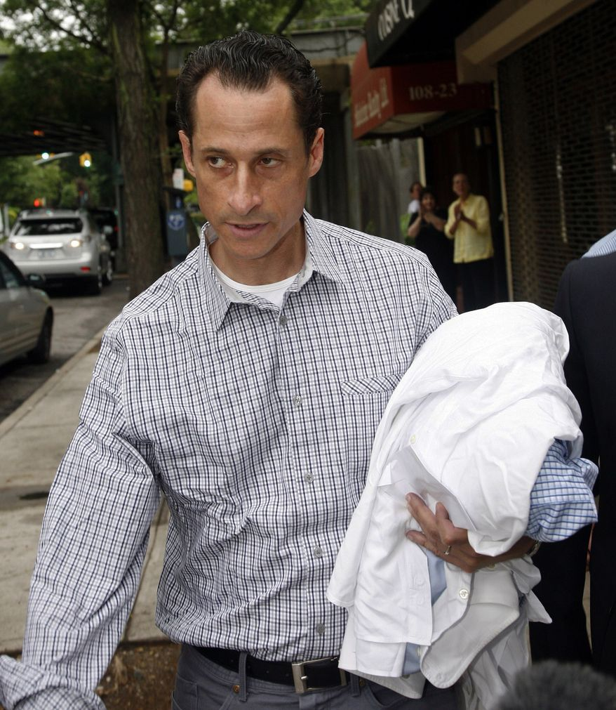 Rep. Anthony Weiner, New York Democrat, carries his laundry to a laundromat near his home in the Queens borough, Saturday, June 11, 2011. The 46-year-old congressman acknowledged Friday that he had online contact with a 17-year-old girl from Delaware but said there was nothing inappropriate. (AP Photo/David Karp)
