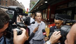 Rep. Anthony Weiner, New York Democrat, is questioned by the media near his home in the Queens borough, Saturday, June 11, 2011. The 46-year-old congressman acknowledged Friday that he had online contact with a 17-year-old girl from Delaware but said there was nothing inappropriate. (AP Photo/David Karp)