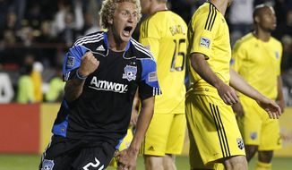San Jose Earthquakes' Steven Lenhart celebrates after scoring a goal against the Columbus Crew during the second half of a game earlier this season. Lenhart scored three times and assisted once in the Earthquakes' 4-2 win over D.C. United.  . (AP Photo/Tony Avelar)