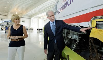 "Former Capt. Chesley ""Sully"" Sullenberger III talks with passenger Pam Seagle as they look at US Airways Flight 1549 at the Carolinas Aviation Museum on Saturday. (Associated Press)"