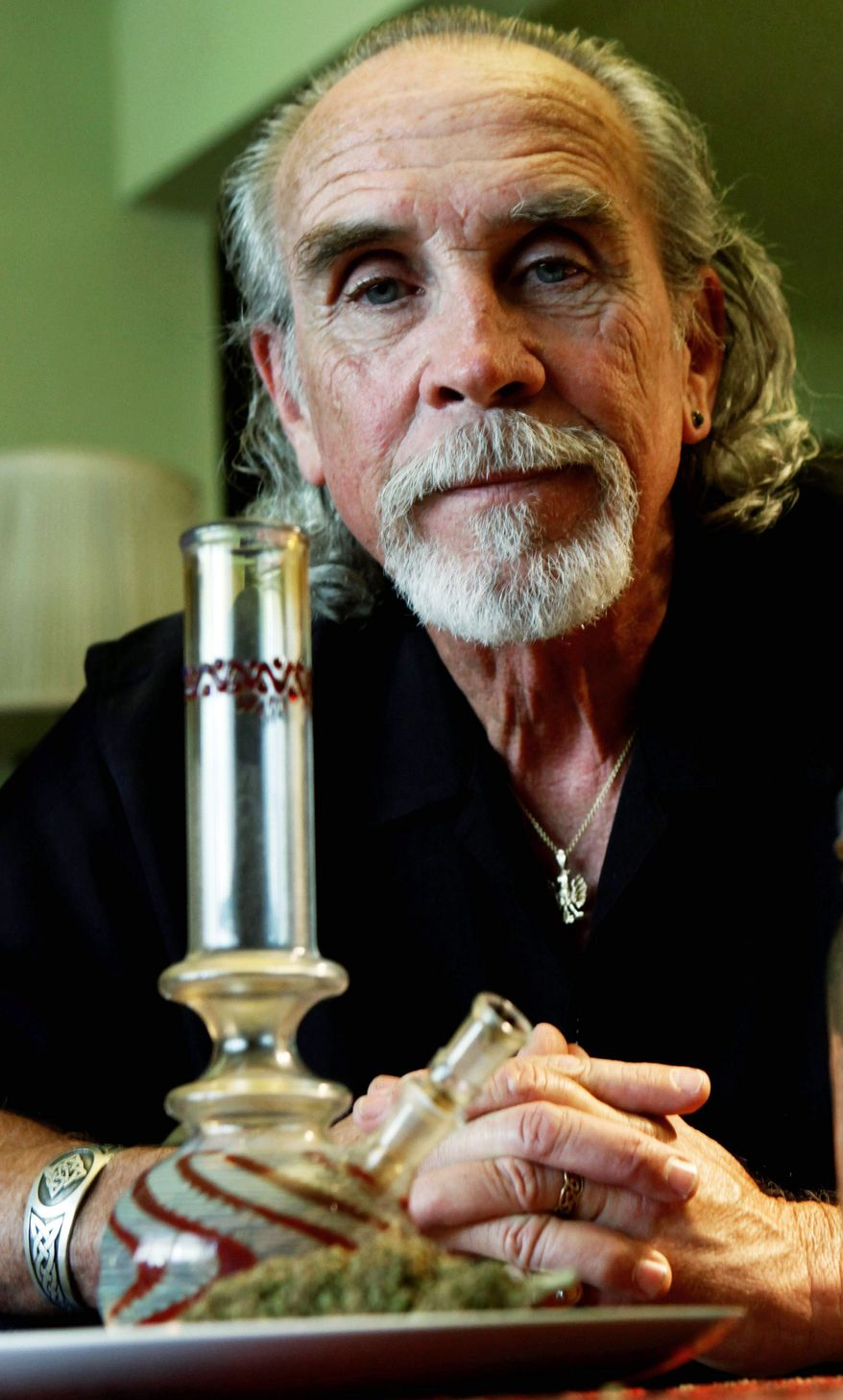 Lonnie Painter, 65, who uses marijuana for medicinal purposes and is the director of Laguna Woods for Medical Cannabis, displays his medicinal herb and bong last month. (Associated Press)
