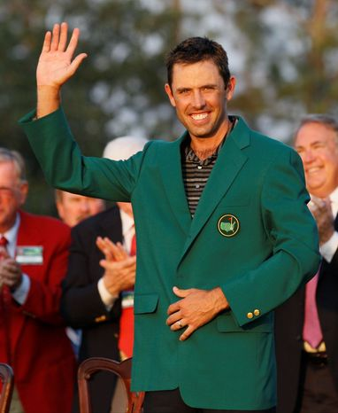 Charl Schwartzel of South Africa waves with his green jacket after winning the Masters championship golf tournament Sunday, April 10, 2011, in Augusta, Ga. (AP Photo/David J. Phillip)