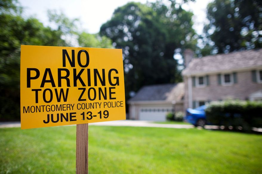 Signs issued by Montgomery County police restrict street parking on Mercy Hollow Lane in Potomac on Sunday. The neighborhood is less than a mile away from Congressional Country Club. (Pratik Shah/The Washington Times)