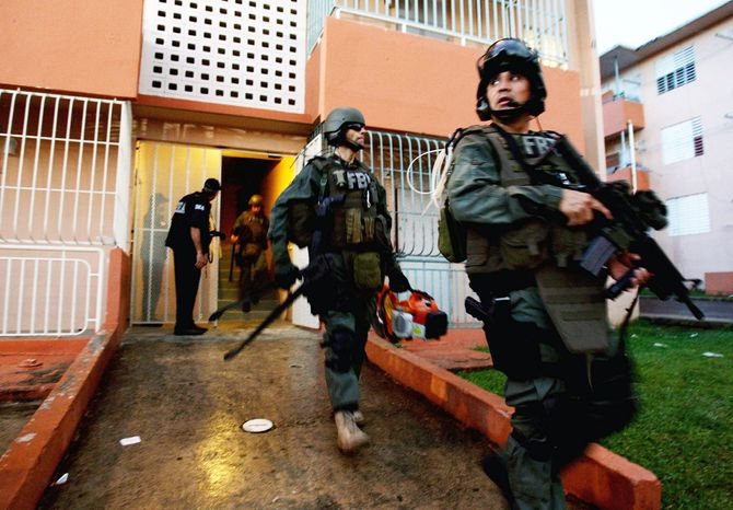 In October 2009, 500 agents swarmed the public housing complex in Bayamon, Puerto Rico, where Ayala-Vazquez grew up and launched his drug empire. Ayala-Vazquez had been captured a month earlier after a seven-year investigation. (Associated Press)