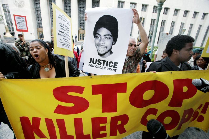 ASSOCIATED PRESS Demonstrators marched to the U.S. District Court building in Los Angeles on Monday to demand that federal prosecutors bring charges against a white transit officer who was released from jail after serving half of a two-year sentence for fatally shooting Mr. Grant, an unarmed black man.