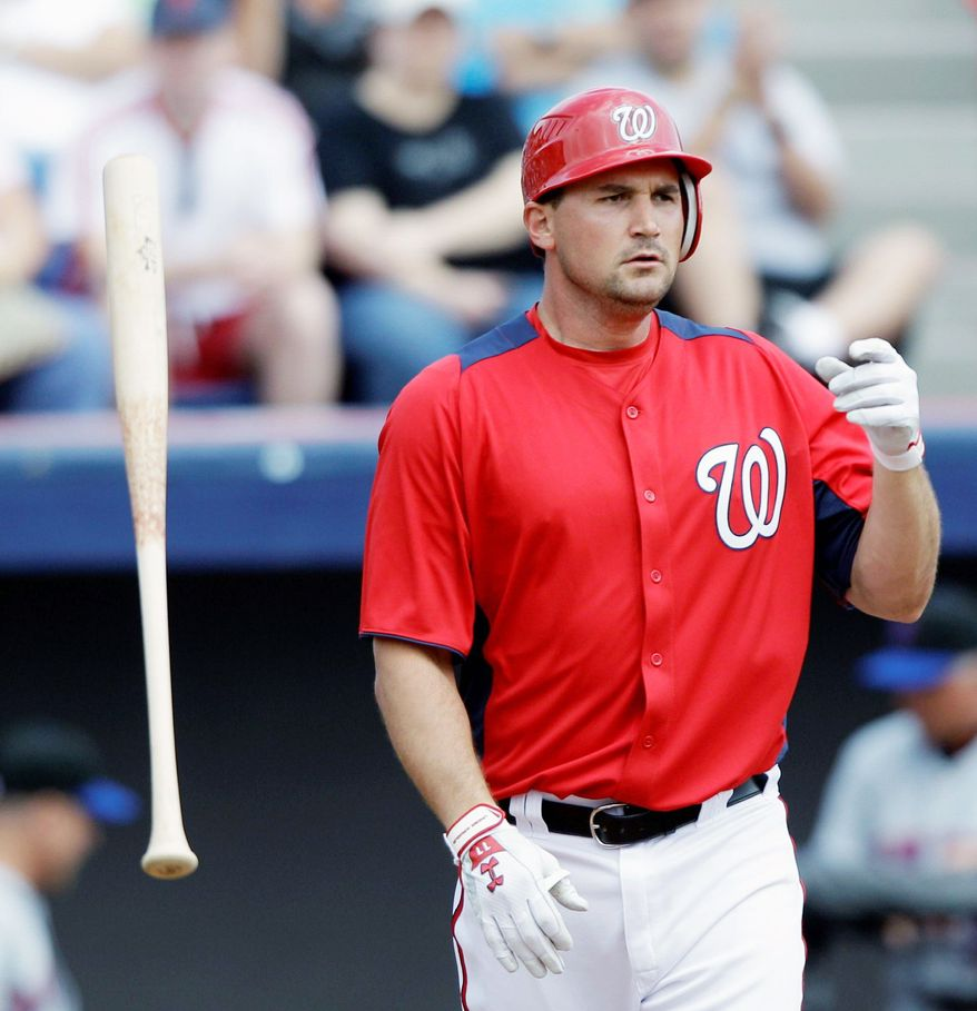 Washington Nationals third baseman Ryan Zimmerman tosses his bat after striking out during the first inning against the New York Mets in a spring training baseball game, Tuesday, March 1, 2011, in Viera, Fla. (AP Photo/David J. Phillip)