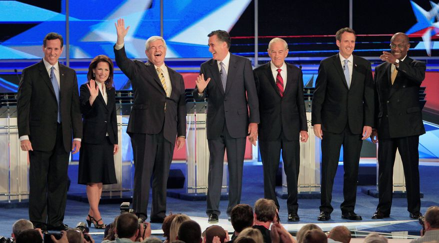 From left, former Sen. Rick Santorum of Pennsylvania; Rep. Michele Bachmann of Minnesota; former House Speaker Newt Gingrich of Georgia; former Massachusetts Gov. Mitt Romney; Rep. Ron Paul of Texas; former Minnesota Gov. Tim Pawlenty; and businessman Herman Cain greet the audience before first New Hampshire Republican presidential debate, at St. Anselm College in Manchester, N.H., Monday. (Associated Press)