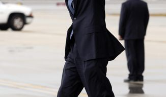 President Barack Obama waves as he arrives at Miami International Airport, Monday, June 13, 2011, in Miami. (AP Photo/Carolyn Kaster)