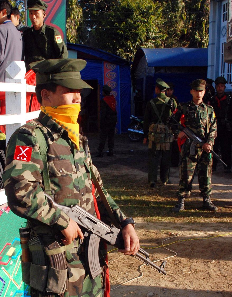 The military wing of the Kachin Independence Army provides security for the Kachin New Year celebration in January 2010. Myanmar troops have attacked Kachin forces to try to drive them from an area by China's border. (Associated Press)