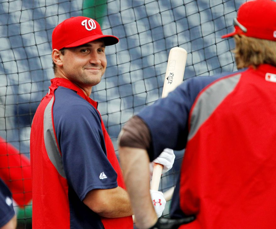 Washington Nationals third baseman Ryan Zimmerman gets ready to take batting practice prior to a baseball game against the St. Louis Cardinals in Washington, Tuesday, June 14, 2011. Zimmerman was reinstated Tuesday from the disabled list after missing 58 games because of an injured abdominal muscle. (AP Photo/Ann Heisenfelt)