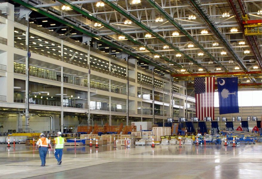Employees go about their business in Boeing Co.'s $750 million final assembly plant in North Charleston, S.C., on Friday. The company's new 787 jetliner assembly plant is at the center of a National Labor Relations Board dispute. (Associated Press)