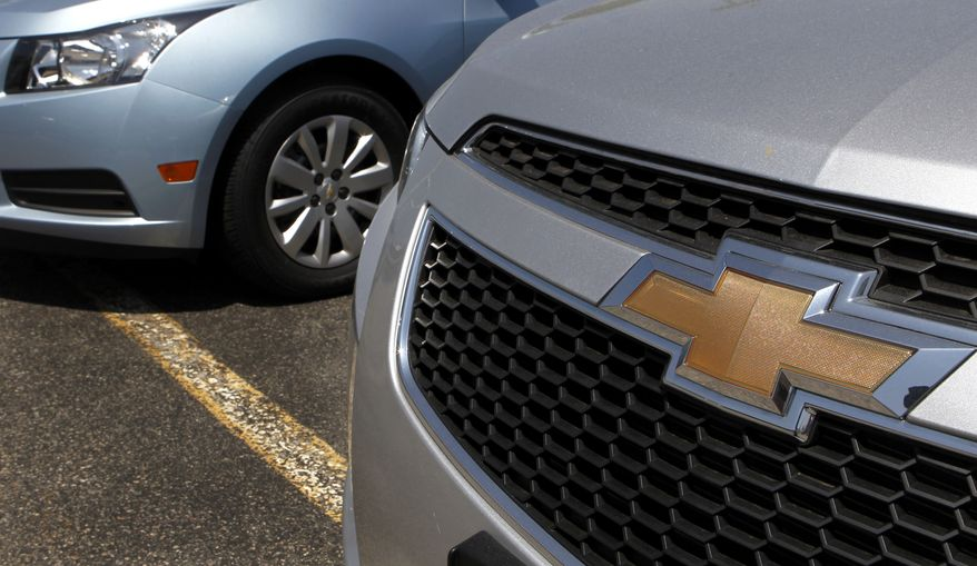 A detail of the grill of a 2011 Chevrolet Cruze compact car (right) is seen near another Cruze on the lot of a dealership in Norwood, Mass., on Tuesday, May 31, 2011. Americans bought fewer cars in May, pulling retail sales down for the first time in nearly a year. (AP Photo/Steven Senne)