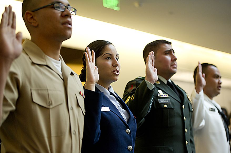 From left, U.S. Marine Cpl. Dominic Vincentz, , originally from Germany; Sr. Airman Deborah Vives, USAF, originally from Mexico; U.S. Army Sgt. Kelvin Magana, originally from El Salvador; and U.S. Navy sailor Halin Edwin, originally from Micronesia, take their oath of citizenship on Flag Day, Tuesday, June 14, 2011 at the National Museum of American History in Washington, D.C. Twenty people from 12 different countries, including these four who have been serving in the U.S. Armed Forces, became naturalized citizens. (Barbara L. Salisbury/The Washington Times)