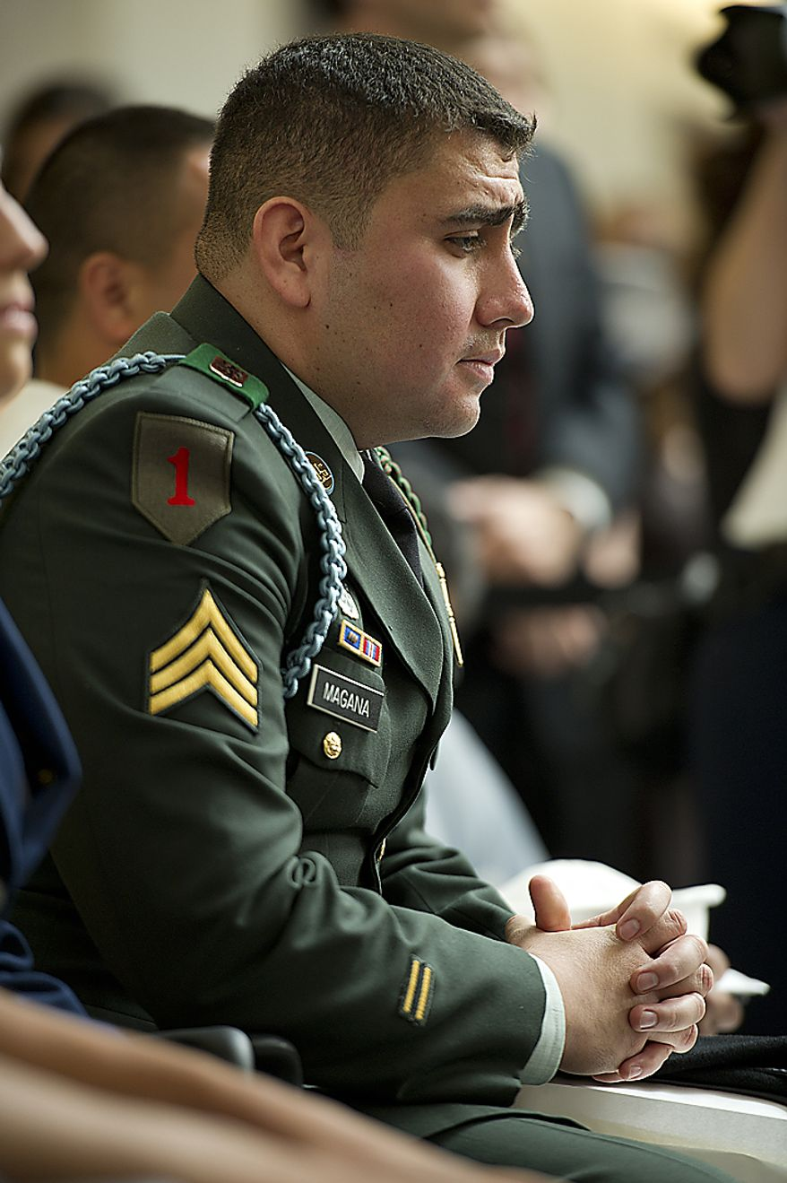 U.S. Army Sgt. Kelvin Magana, originally from El Salvador but now living in Manassas, Va.,id lost in thought after becoming a naturalized American citizen on Flag Day, Tuesday, June 14, 2011 at the National Museum of American History in Washington, D.C.  Twenty people from 12 different countries, including four people serving in the U.S. Armed Forces, became citizens during the ceremony. (Barbara L. Salisbury/The Washington Times)