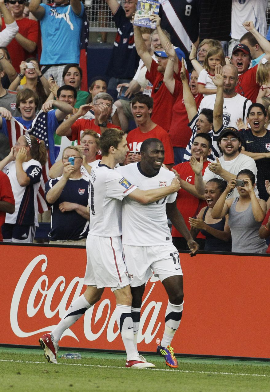 USA attacker Jozy Atidore (17) is congratulated by teammate Clarence Goodson (21) following his goal against Guadeloupe during the first half of a Gold Cup soccer match in Kansas City, Kan. USA won 1-0 and will play Jamaica in the quarterfinals Sunday in Washington, D.C. (AP Photo/Orlin Wagner)