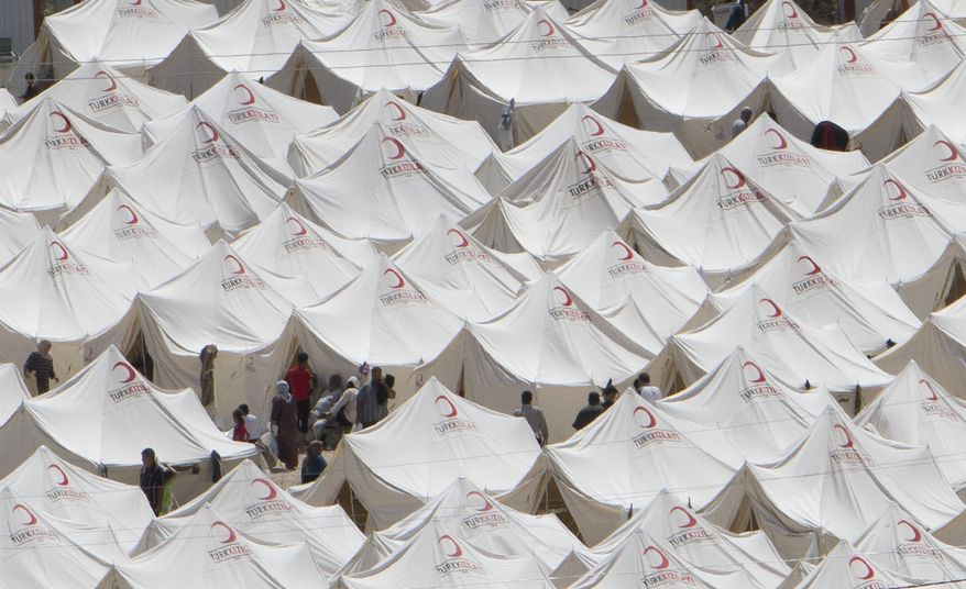 Syrian refugees are seen in a camp, in Boynuyogun, Turkey, on June 14, 2011. According to the Turkish Prime Minister's office, the number of Syrian refugees in Turkey stands at more than 8.500 people. (Associated Press)