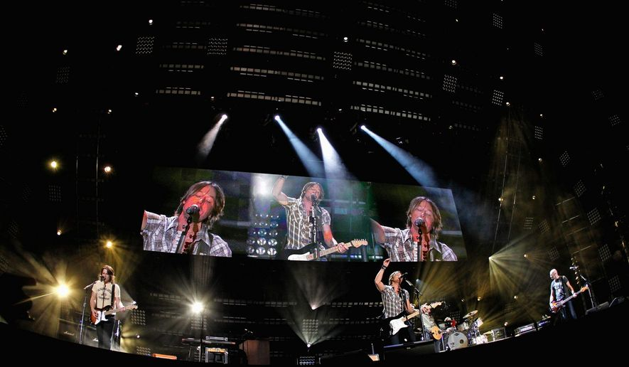 ASSOCIATED PRESS Keith Urban performs during the Country Music Association's Fan Fest last week in Nashville, Tenn. His latest tour starts Thursday in Biloxi, Miss.