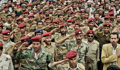 ASSOCIATED PRESS Yemeni army officers and soldiers who have defected salute during a demonstration Wednesday by anti-government protestors demanding the resignation of President Ali Abdullah Saleh in the capital. Islamic militants emboldened by months of turmoil launched a surprise dawn attack Wednesday on a southern city, seizing entire neighborhoods after gunfights with government forces.