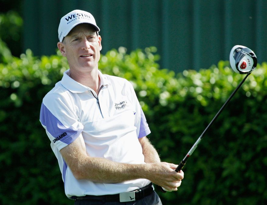 Jim Furyk watches his shot from the ninth tee during the Pro-Am competition at the Arnold Palmer Invitational golf tournament in Orlando, Fla., Wednesday, March 23, 2011. (AP Photo/John Raoux)