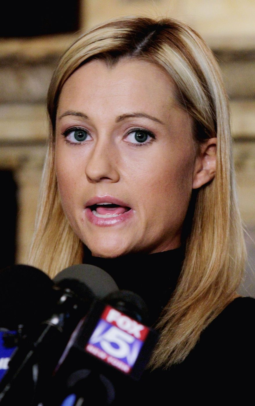 ASSOCIATED PRESS Former porn actress Ginger Lee reads her prepared statement a news conference at the Friars Club, in New York, Wednesday, June 15, 2011. Lee, who said she exchanged emails and messages over Twitter with New York Rep. Anthony Weiner, said Wednesday that he asked her to lie about their online communications. (AP Photo/Richard Drew)