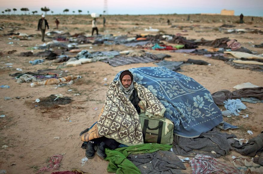 ASSOCIATED PRESS SEEKING REFUGE: A man from Bangladesh who fled Libya sits at a refugee camp in Tunisia.