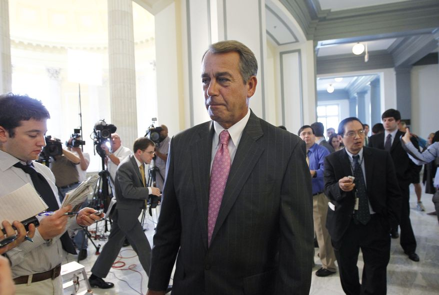 House Speaker John Boehner finishes a news conference following a political strategy session on Capitol Hill in Washington, Tuesday, June 14, 2011. (AP Photo/J. Scott Applewhite)
