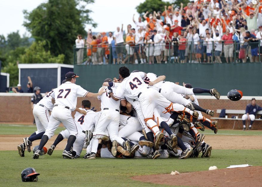 Virginia celebrates a 3-2 win over UC Irvine in Game 3 of the NCAA Super Regional baseball tournament Sunday, June 13, 2011, in Charlottesville, Va. Virginia advances to the College World Series in Omaha, Neb. (AP Photo/Andrew Shurtleff)
