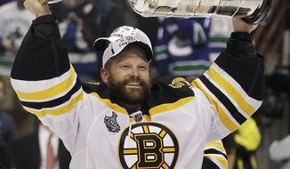 Boston Bruins goalie Tim Thomas hoists the Stanley Cup after the Boston Bruins beat the Vancouver Canucks 4-0 during Game 7 of the NHL hockey Stanley Cup Finals, Wednesday, June 15, 2011, in Vancouver, British Columbia. (AP Photo/Julie Jacobson)