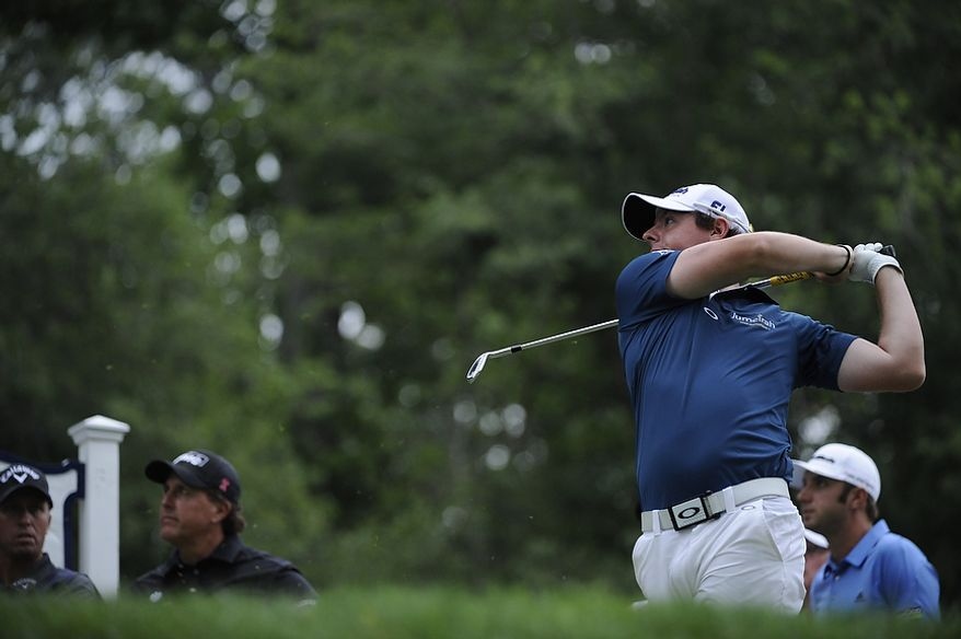 Tournament leader Rory McIlroy, of Northern Ireland, tees off on the par 3, 7th hole during the first round of the U.S. Open at Congressional Country Club in Bethesda, Md., Thursday, June 16, 2011. He finished with a 6-under 65. (Drew Angerer/The Washington Times)