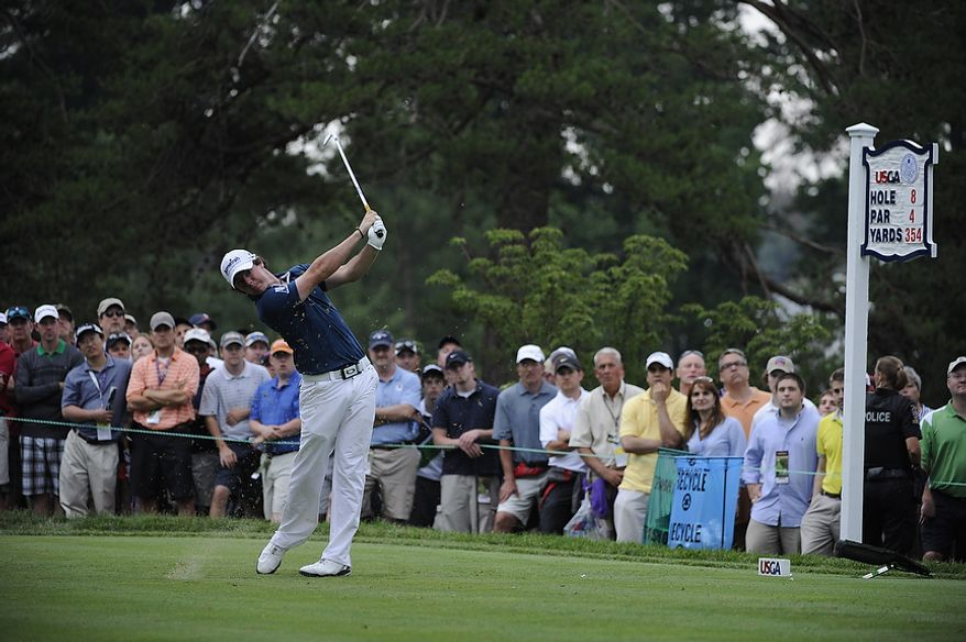 Tournament leader Rory McIlroy, of Northern Ireland, hits a tee shot on the 8th hole during the first round of the U.S. Open at Congressional Country Club in Bethesda, Md., Thursday, June 16, 2011. He finished with a 6-under 65. (Drew Angerer/The Washington Times)