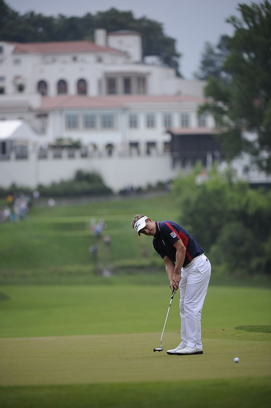 Luke Donald, of England, sinks a birdie putt on the 11th hole during the first round of the U.S. Open at Congressional Country Club in Bethesda, Md., Thursday, June 16, 2011. (Drew Angerer/The Washington Times)